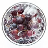 Juicy, rich grapes with ice in a glass