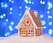 Gingerbread House In The Snow With A Beautiful New Year's Background