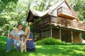 stock photo of chalet  - A young attractive happy family of three - JPG