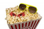 stock photo of matinee  - Horizontal shot of a large tub of popcorn with red movie tickets and sunglasses and shot on a white background - JPG