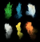foto of freeze  - Freeze motion of colored dust explosion isolated on black background - JPG