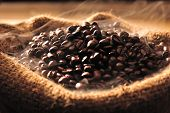 foto of coffee crop  - Coffee beans with smoke in a bag - JPG