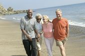 image of friendship day  - Happy couples walking together on beach - JPG