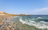 Ocean Waves Crashing Against A Pebble Shore