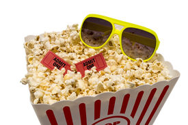 picture of matinee  - Horizontal shot of a large tub of popcorn with red movie tickets and sunglasses and shot on a white background - JPG