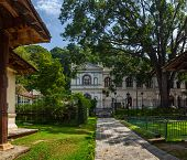 Garden with Museum of World Buddhism on the background. City of Kandy, Sri Lanka