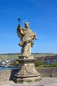 Statue of St John of Nepomuk on Old bridge (Alte Mainbruecke) in Wurzburg, Germany.