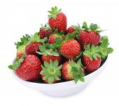 a bowl with some appetizing strawberries on a white background