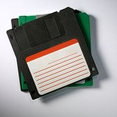 Vintage floppy disks on white cardboard