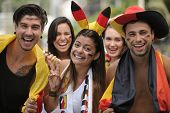 Group of enthusiastic German sport soccer fans celebrating victory.