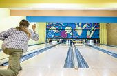 Active Person In Bowling Playground Throws The Bowling Ball On Lane