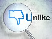 Social media concept: Thumb Down and Unlike with optical glass