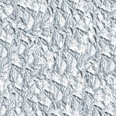 Crinkled tinfoil as a silver colors seamless background