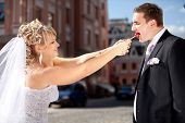bride taking lollipop from groom while he was eating it