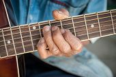 Hands Of The Old Man Hold Guitar