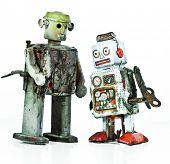 two burnt robot toys