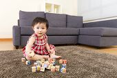 Little girl play with toy block