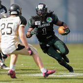 VIENNA,  AUSTRIA - APRIL 14 RB Tunde Ogun (#1 Dragons) runs with the ball during the AFL football ga