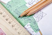 Topographic Map And Pencils Close Up