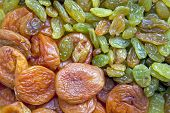 Scattering of dried fruit : raisins and dried apricots
