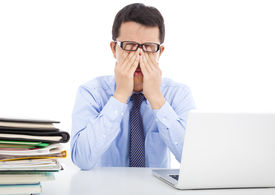 picture of fatigue  - businessman is too fatigued to rubbing his eyes in office - JPG