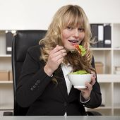 Smiling Businesswoman Enjoying A Healthy Salad