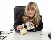Smiling Happy Businesswoman With Piggy Bank