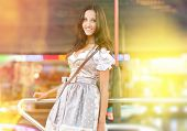 Beautiful German Woman posing and wearing a traditional Dirndl