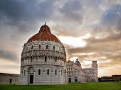 Piazza dei Miracoli; in foreground the Baptistry, the Dome, then the leaning tower of Pisa, Italy.