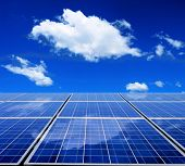 image of solar battery  - Solar energy panel with blue sky and clouds - JPG