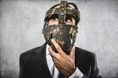 thinking, dangerous business man with iron mask and expressions