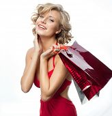 portrait of attractive  caucasian smiling woman blond isolated on white studio shot  toothy smile  hair  looking at camera shopping bags sale