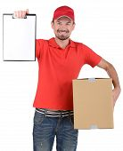 stock photo of fragile sign  - Happy smiling delivery man signing papers for delivery - JPG