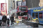 Investigators inspect damaged buses