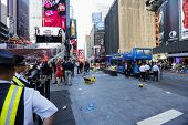Security personnel alongside Duffy Square