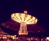 a ride at a local state fair toned with a vintage retro instagram filter