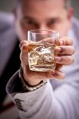 Glass Of Alcoholic Drink In Man's Hand
