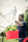 Young man hanging up laundry