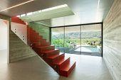 Interior, red staircase in modern villa