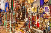 JERUSALEM, ISRAEL - JULY 10, 2014: Gift shop on bazaar in Old City of Jerusalem offers middle east t