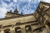 pic of fortified wall  - Clock Tower and weathered walls of the medieval fortified citadel of Sighisoara Romania one of the few still inhabited citadels in Europe and a UNESCO World Heritage Site - JPG