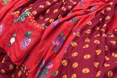 stock photo of traditional attire  - Detail of colorful traditional gipsy dresses fabrics with floral patterns - JPG