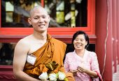 Buddhist monk with mother