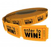 stock photo of word charity  - Enter to Win words on a roll of orange raffle or lotter tickets as a fundraiser for charity or contest for lucky players - JPG
