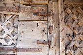 600 years old wooden doors with metal frame work and lock