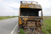 pic of truck-cabin  - Truck cabin destroyed in fire on side of the road - JPG