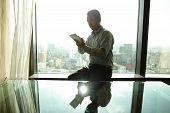 Business Man Using Digital Tablet