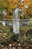 Cross In A Cemetery In Autumn