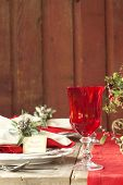Christmas Dining Scene On Rustic Wood Table And Wall