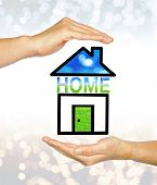 image of economizer  - The Home in hands on bokeh background - JPG